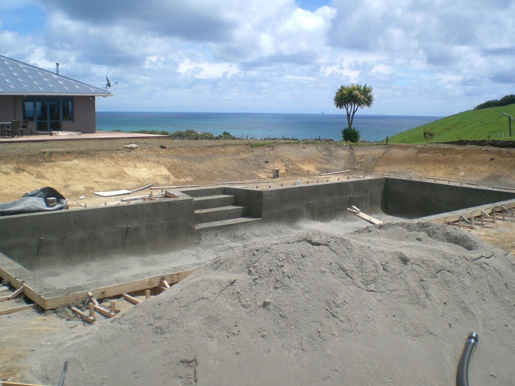 Concrete swimming pool construction home design for Swimming pool construction company