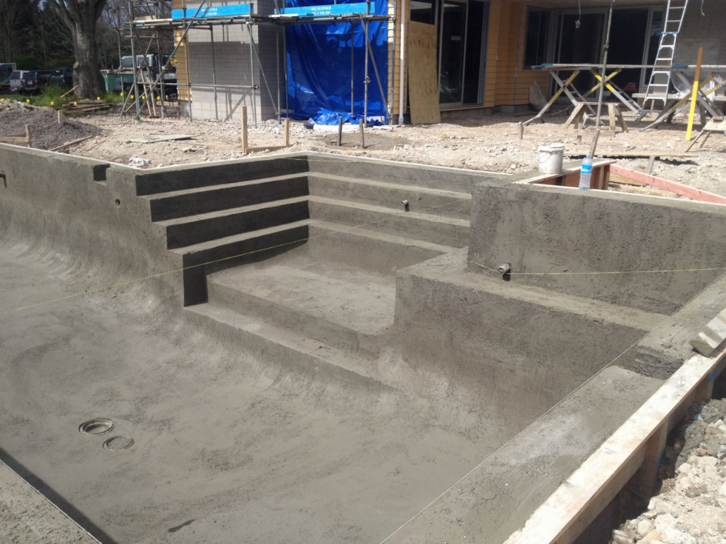 General construction concrete swimming pool photo for Swimming pool builders